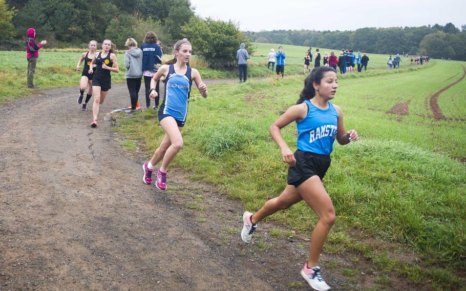Ramstein's McKenzie Perkes pulls ahead of Black Forest Academy's Bianca Liberti and Stuttgart's Alycia Smith and McKinley Fielding during a cross country meet in Ramstein-Miesenbach, Germany, on Saturday, Oct. 21, 2017.