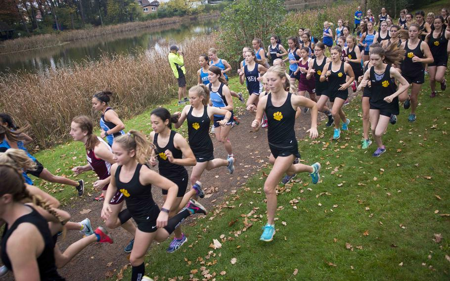 Runners take off from the starting line during a cross country meet in Ramstein-Miesenbach, Germany, on Saturday, Oct. 21, 2017.