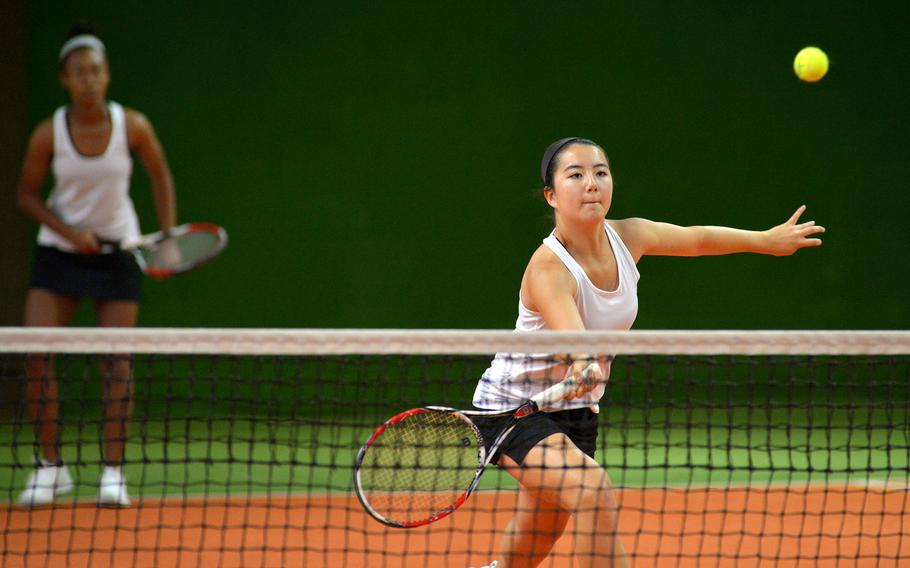 Stuttgart's Hannah Cahill keeps her eyes on the ball as she prepares to make a return at the DODEA-Europe tennis championships in Wiesbaden, Germany, Thursday, Oct. 26, 2017. Cahill and teammate Kandis Ajyman defeated Alara Kocabas and Annette Belleman of Brussels 6-2, 6-4.