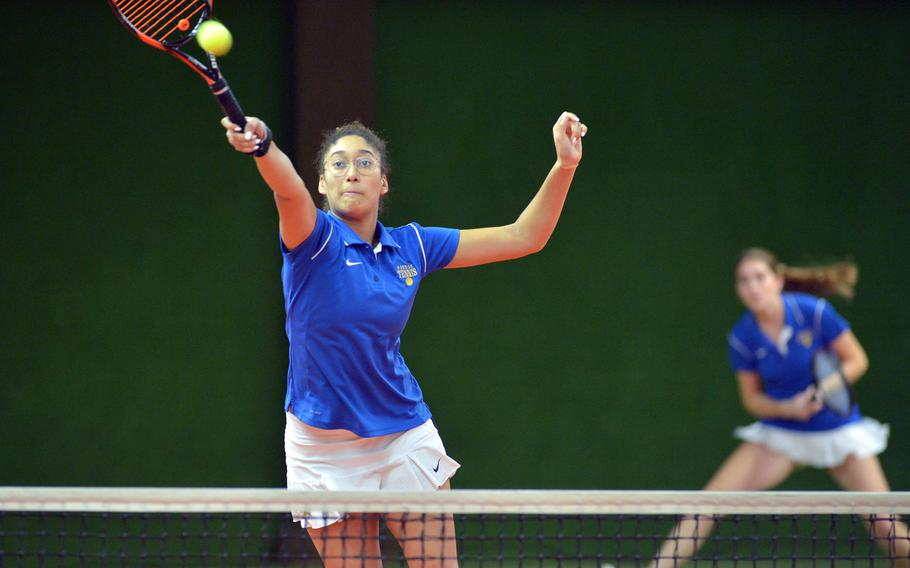 Wiesbaden's Melissa Pritchett leaps to return a shot in a girls double match against Kaiserslautern as teammate Shelby Albers watches. The pair defeated Josephine Little and Margaret Cayce 6-0, 6-1 at the DODEA-Europe tennis championships in Wiesbaden, Germany, Thursday, Oct. 26, 2017.
