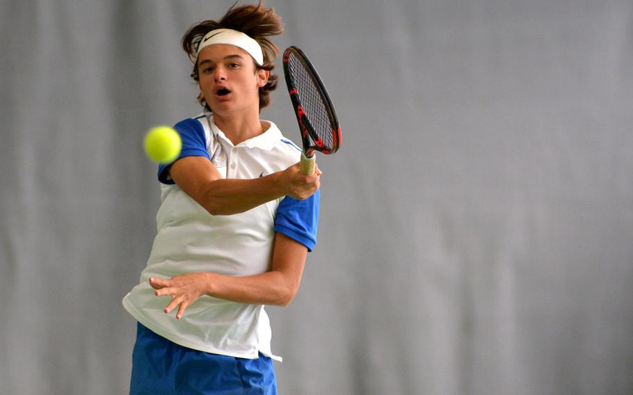 Defending boys champ, Mathias Mingazzini returns a shot from Brussels' Aljaz Urbanc at the DODEA-Europe tennis championships in Wiesbaden, Germany, Thursday, Oct. 26, 2017. He won the match 6-0, 6-0.
