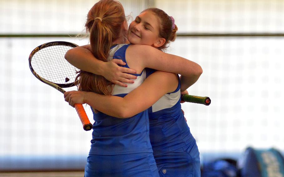 Ramstein's Amanda Daly, right, hugs teammate Megan Stretch after beating SHAPE's Nikola Janigova and Maria Rebream 6-0, 6-2 to advance to Saturday's doubles final at the DODEA-Europe tennis championships in Wiesbaden, Germany, Friday, Oct. 27, 2017.