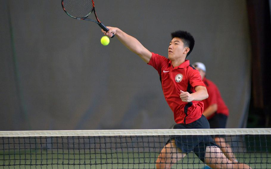 American Overseas School of Rome's William Hsia slams the ball over the net for a point in a doubles semifinal match at the DODEA-Europe tennis finals in Wiesbaden, Germany, Friday, Oct. 27, 2017. Hsia and teammate Federico Sarti beat Stuttgart's Bradley Roxbury and Bradley Russell 6-1, 6-0 to advance to Saturday's final