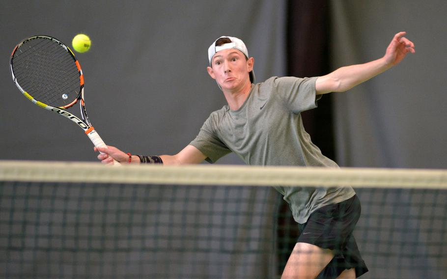 Stuttgart's Zach Snow reaches to make a return against SHAPE's Noah Banken in a semifinal at the DODEA-Europe tennis finals in Wiesbaden, Germany, Friday, Oct. 27, 2017. Snow lost 6-0, 6-3.
