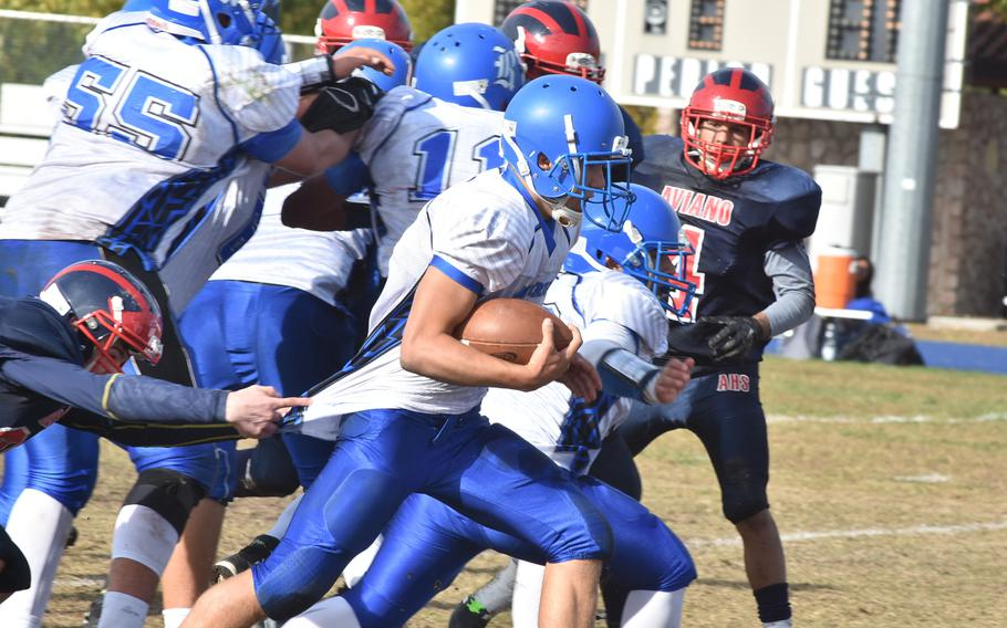 It took more than a weak grip on his jersey to keep Rota quarterback Wes Penta from scoring on this play Saturday in the Admirals' 26-21 victory over Aviano.
