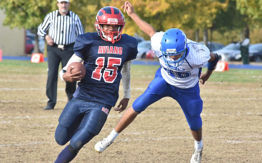 Aviano's Donavin Robinson eludes the tackle of Rota's Joe Perches on Saturday in the second half of Rota's 26-21 victory that sent the Admirals into the Division II championship game.