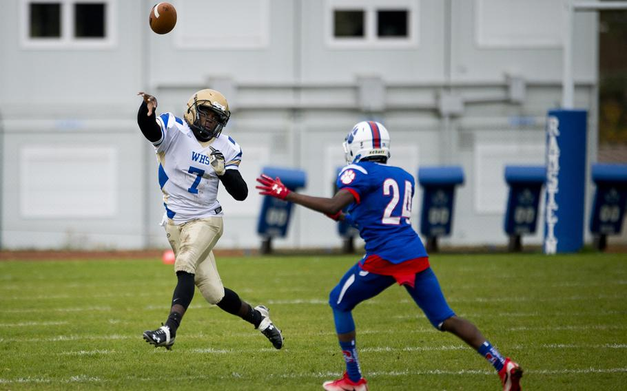 Wiesbaden's Josh Blake throws a pass over Ramstein's Cameron Chester during the DODEA-Europe Division I semifinal at Ramstein Air Base, Germany, on Saturday, Oct. 28, 2017.