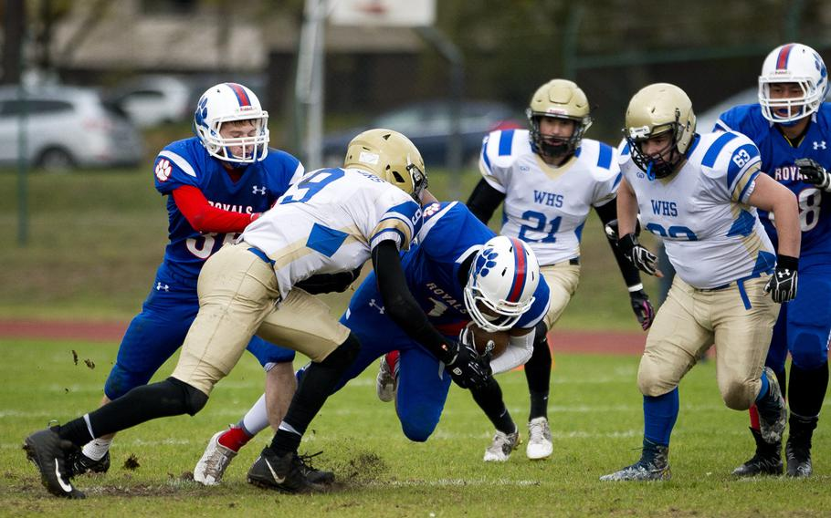 Ramstein's Gevaughn  Bracy is brought down by Wiesbaden's Sam Edwards during the DODEA-Europe Division I semifinal at Ramstein Air Base, Germany, on Saturday, Oct. 28, 2017. Ramstein won 13-6.
