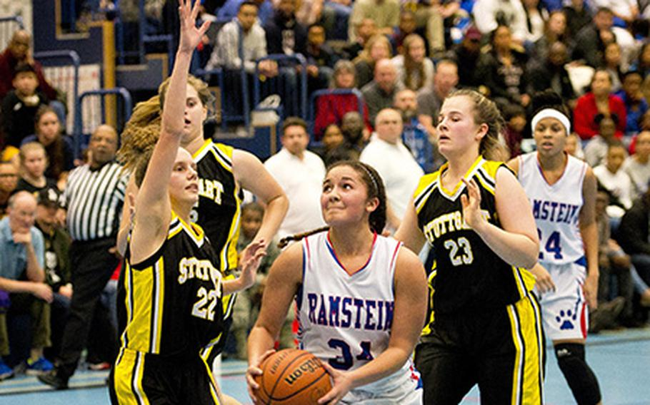 Ramstein's Haley Deome, right, prepares to go for a shot over Stuttgart's Adan Maher at Ramstein Air Base, Germany, on Friday, Jan. 12, 2018. Ramstein won 39-37 in overtime.