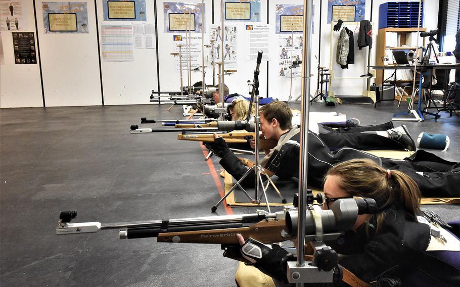 Shooters eye their targets during a marksmanship match at Ansbach, Germany, Saturday, Jan. 20, 2018.