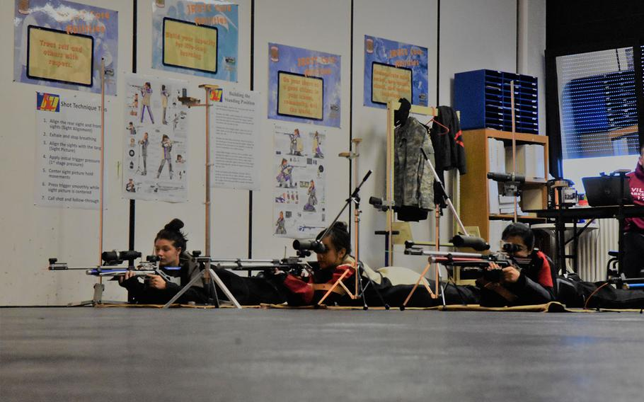 Jackie Muszczynski, left, from Ansbach, and Vilseck shooters Mikaela Motherwell, and Alyssa Garcia, take aim during a marksmanship match at Ansbach, Germany, Saturday, Jan. 20, 2018.