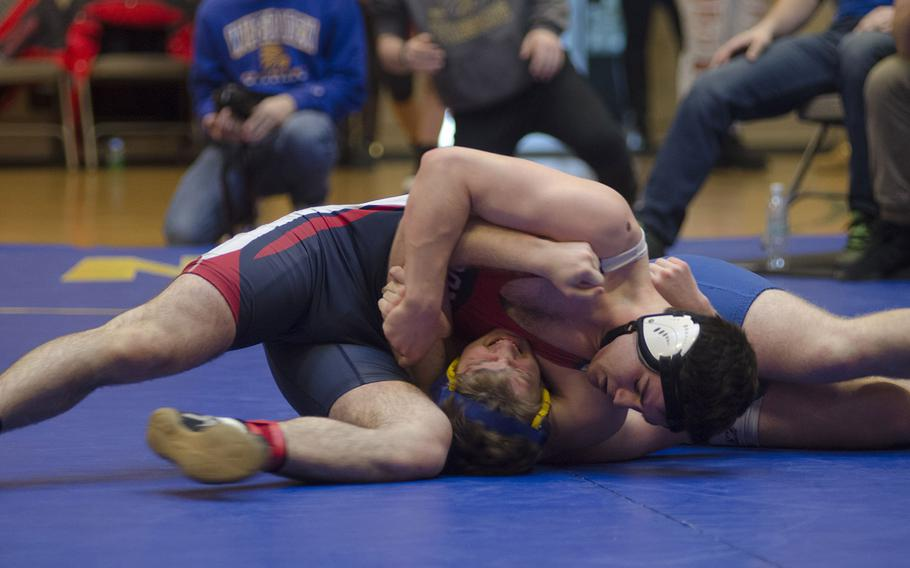Spangdahlem's Tyler McChord, left, grapples with Wiesbaden's Tristan Laliberte during a four-team meet in Wiesbaden, Germany, Saturday, Jan. 27, 2018. McChord won despite wrestling above his weight class.