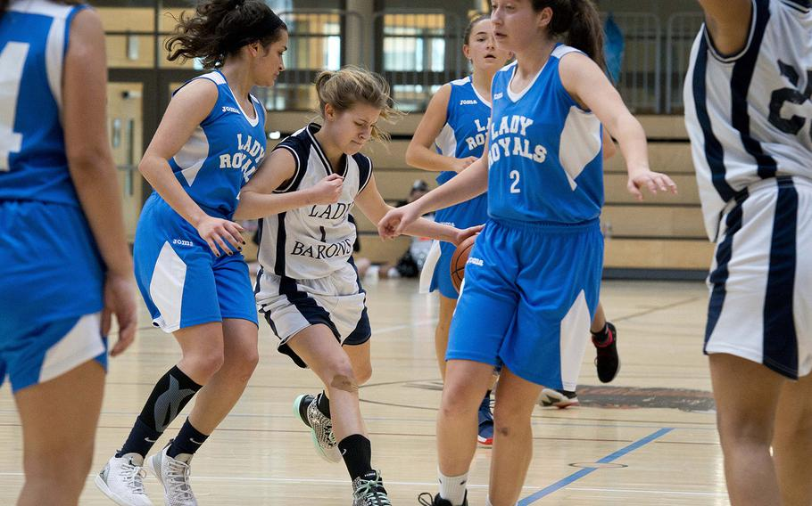 Spangdhalem's Ava Bohn tries to split Marymount's Marian Hassan, left, and Andrea Riviere during the DODEA-Europe basketball semifinals in Wiesbaden, Germany, on Friday, Feb. 23, 2018. Spangdhalem won the Division II game 23-18.