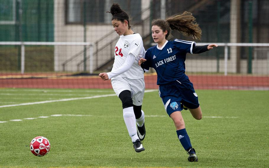 Kaiserslautern's Dezirea Johnson, left, and Black Forest Academy's Debbie Widmer race for the ball in Kaiserslautern, Germany, on Saturday, March 17, 2018. Kaiserslautern and BFA tied the game 1-1.