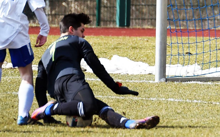 Ansbach goalie Nick Benson dives onto the ball during a game at Hohenfels, Germany, Saturday, March 24, 2018.