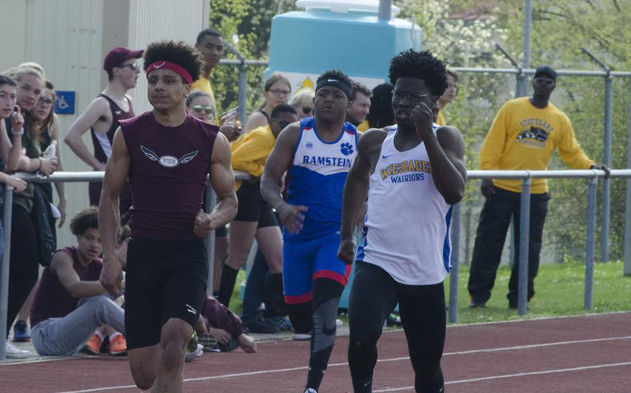Vilseck's Devin Gamble, left, and Wiesbaden's Caleb Brown near the finish line in the 200 meters during a 10-team meet in Wiesbaden, Germany, Saturday, April 14, 2018. Gamble edged out Brown by .06 seconds.