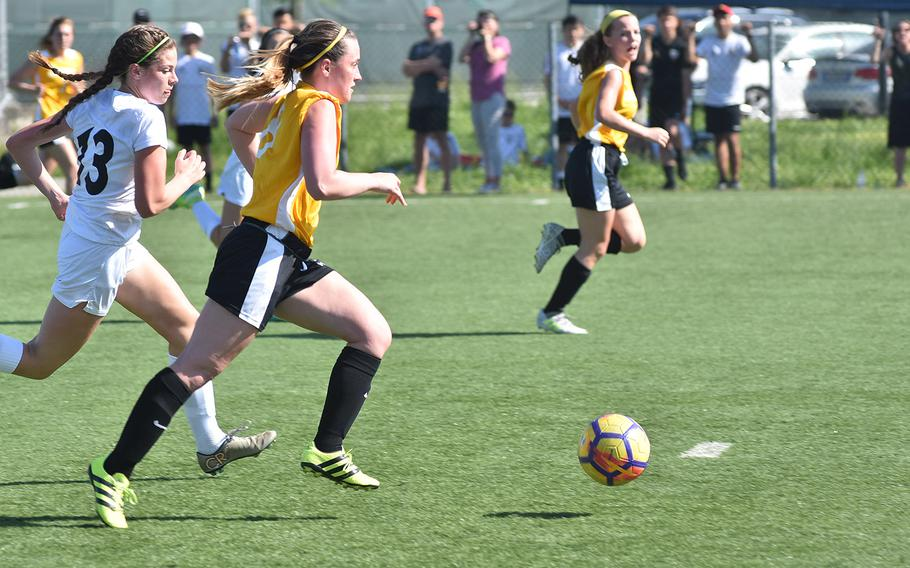 It's off to the races as Stuttgart's Callie McGurk leads Naples' Kyra Barrows and a host of other players toward the Naples goal on Friday, April 20, 2018, in Vicenza, Italy.