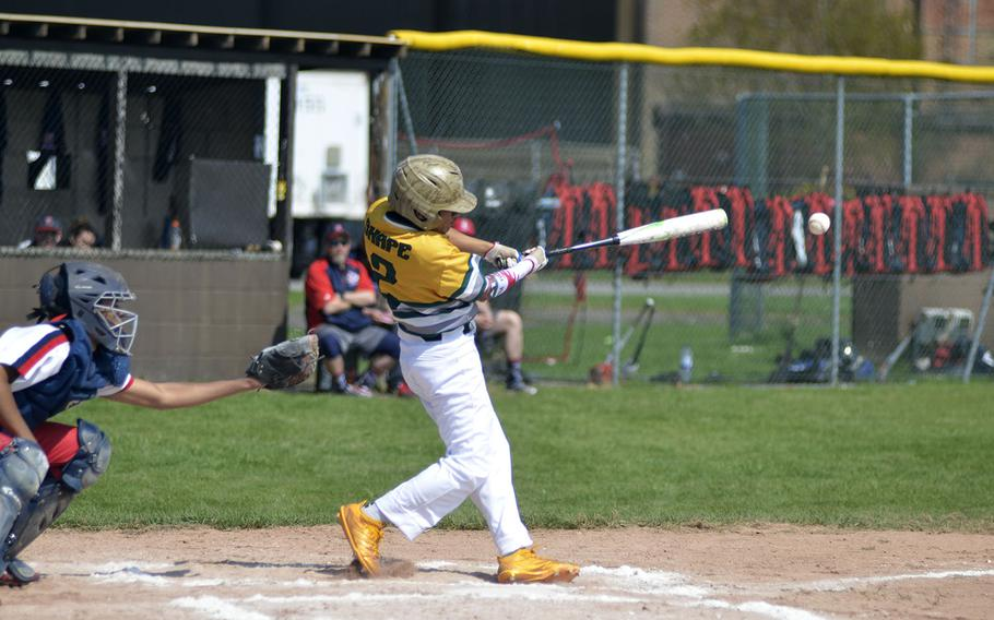 SHAPE's Jared Gallegos gets a base hit against the Lancers during a high school baseball doubleheader at RAF Feltwell, England, Saturday, April 21, 2018. The Spartans beat the Lancers in both games.
