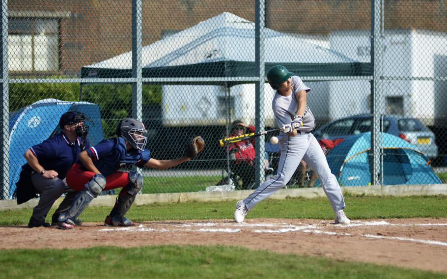 SHAPE baseball player Anthony Gordon hits a pitch against the Lancers during a high school doubleheader at RAF Feltwell, England, Saturday, April 21, 2018. The Spartans won both games.