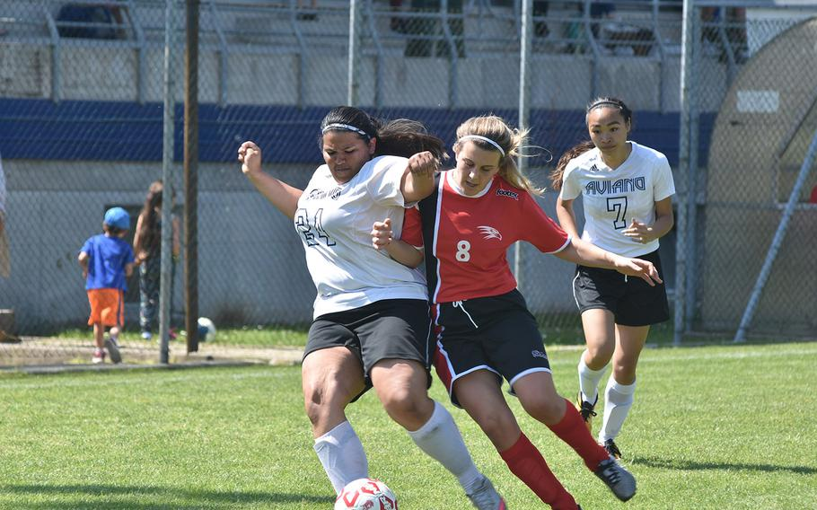 Aviano's Jocelyn Sauceda and American Overseas School of Rome's Virginia Amici collide while trying to get the ball in the Falcons' 3-1 victory on Saturday, April 21, 2018.