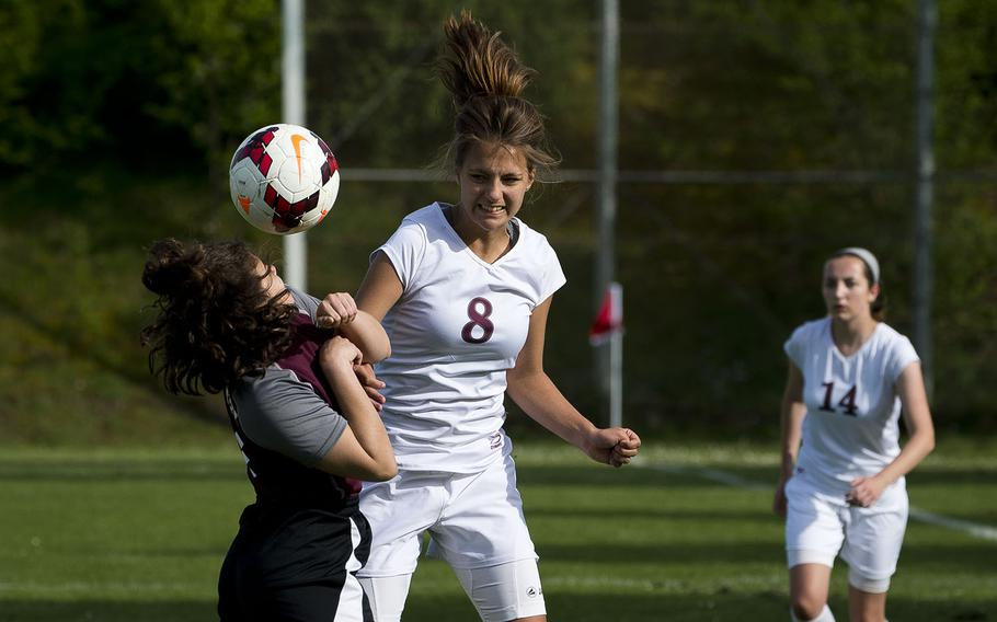 Baumholder's Lydia Coyour, right, heads the ball past AFNORTH's Melany Macauley in Baumholder, Germany, on Friday, April 27, 2018. Baumholder lost the game 10-1.