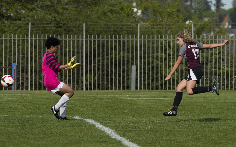 AFNORTH's Paige Vanden, right, gets a shot past Baumholder's Ariana Edwards in Baumholder, Germany, on Friday, April 27, 2018. AFNORTH won the game 10-1.