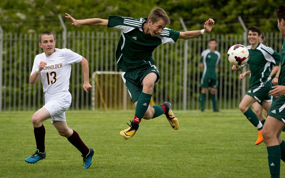 AFNORTH's Lasse Bohlen, right, passes the ball behind him as Baumholder's Toren Woodstock watches in Baumholder, Germany, on Friday, April 27, 2018.