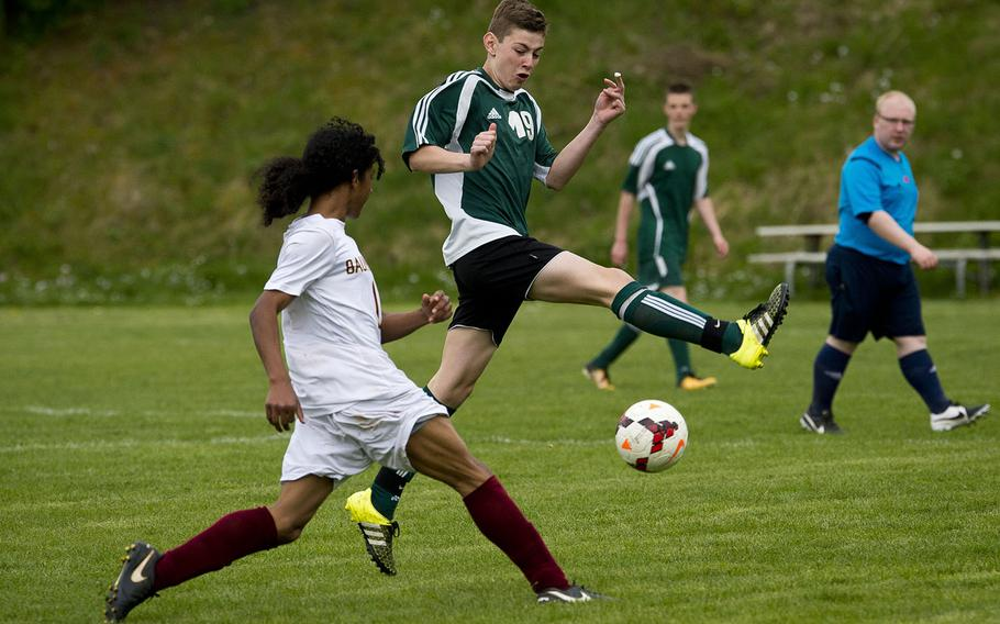 Baumholder's Demauriay Medina, left, passes the ball under AFNORTH's Paul Kohl in Baumholder, Germany, on Friday, April 27, 2018.