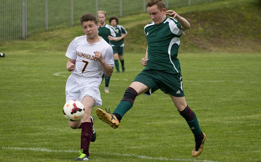 AFNORTH's Damien Corser, right, passes the ball in front of Baumholder's Noel King in Baumholder, Germany, on Friday, April 27, 2018. AFNORTH won the game 15-0.
