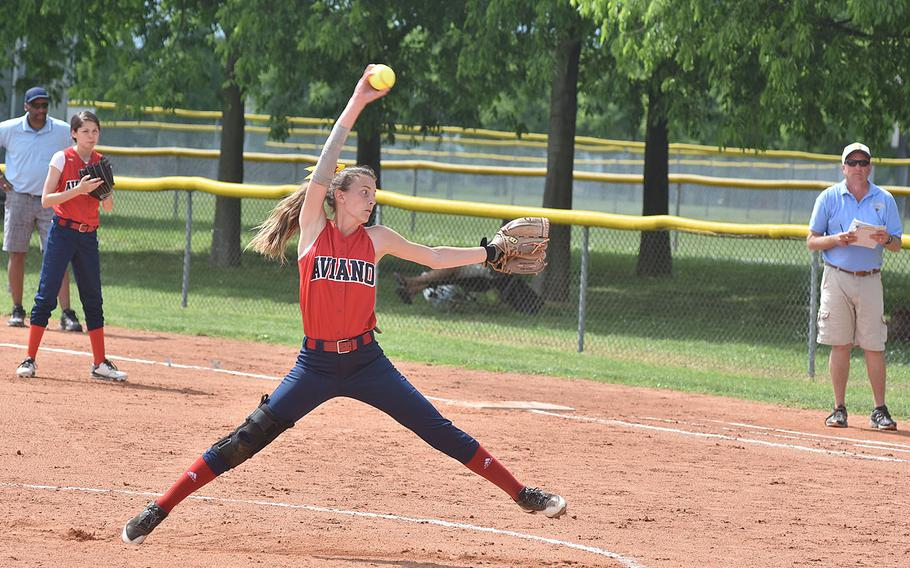 Aviano's Lizzy Bond extends fully while maknig a pitch toward home on Saturday, April 28, 2018 in the Saints' 7-6 loss to Sigonella.
