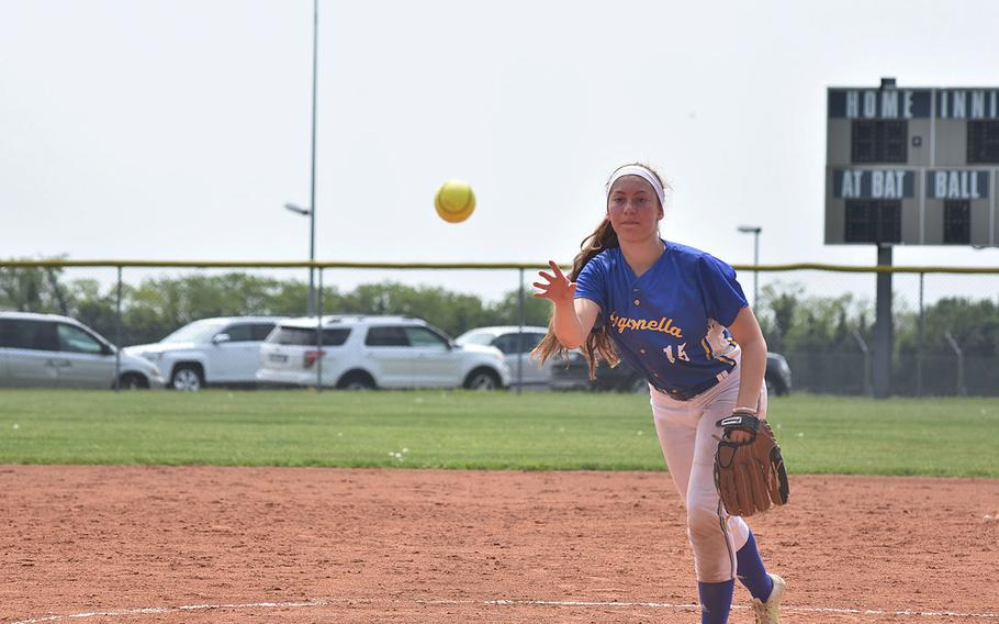 Sigonella's Jessica Jacobs tosses the ball toward home while throwing a no-hitter against Hohenfels on Saturday, April 28, 2018. The Jaguars won 10-0.