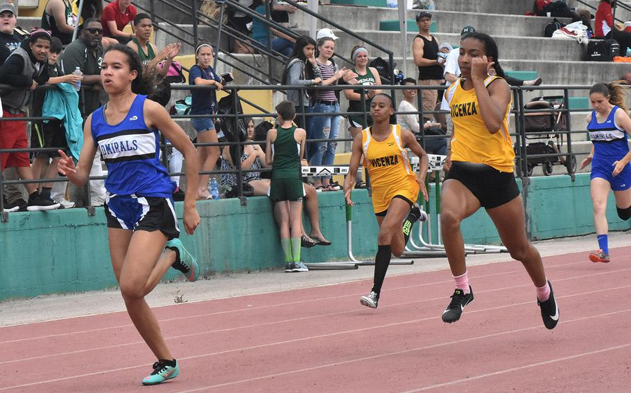 Rota's Deja Alexis sprints to victory in the 100-meter run on Saturday May 12, 2018 at Naples Middle High School in Gricignano, Italy.