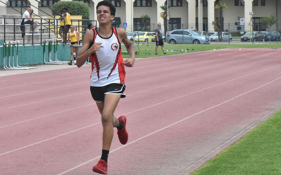 American Overseas School of Rome's William Davis pulls ahead of the pack to win the 1,600 on Saturday, May 12, 2018 at Naples Middle High School in Gricignano, Italy.