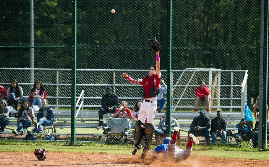 Ramstein's Nathan Kranz slides into home ahead of a throw to Kaiserslautern's Ronin Sherman in Kaiserslautern, Germany, on Saturday, May 19, 2018.