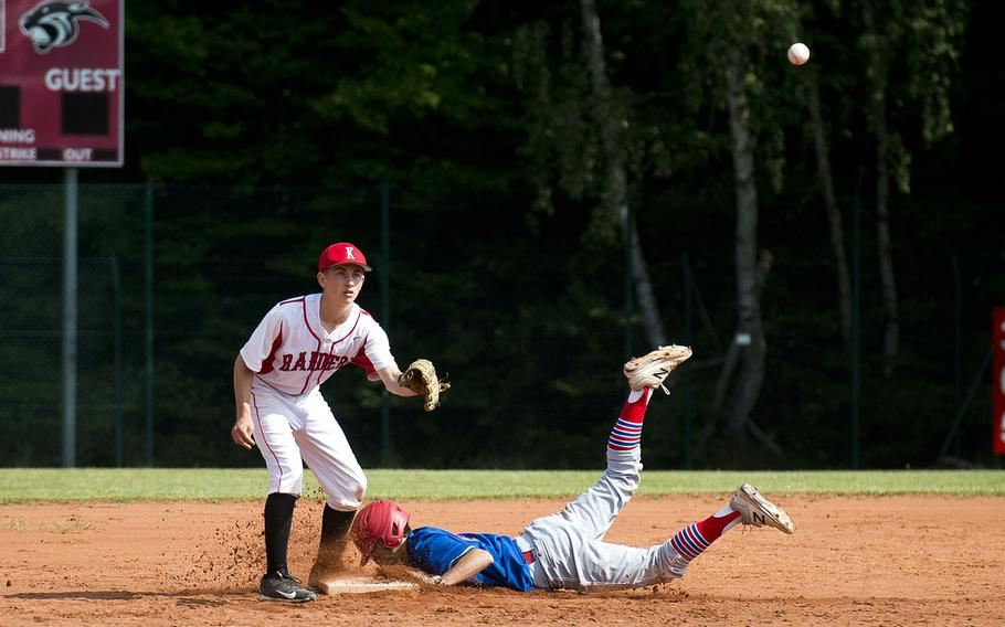 Ramstein's Kaleb Bellew slides in safe at second ahead of a throw to Kaiserslautern's Mark Hoyt in Kaiserslautern, Germany, on Saturday, May 19, 2018.