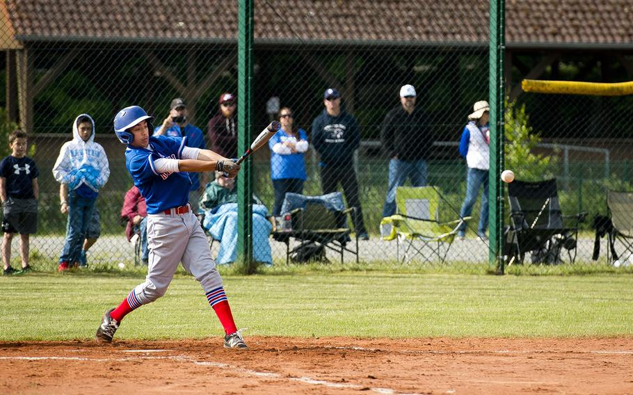 Ramstein's Christopher Guzaldo hits the ball during a game in Kaiserslautern, Germany, on Saturday, May 19, 2018. Ramstein defeated Kaiserslautern 6-5.