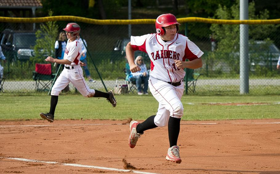 Kaiserslautern's Justice Harper, right, runs to first as Mark Hoyt makes it home during a game in Kaiserslautern, Germany, on Saturday, May 19, 2018. Kaiserslautern lost to Ramstein 6-5.