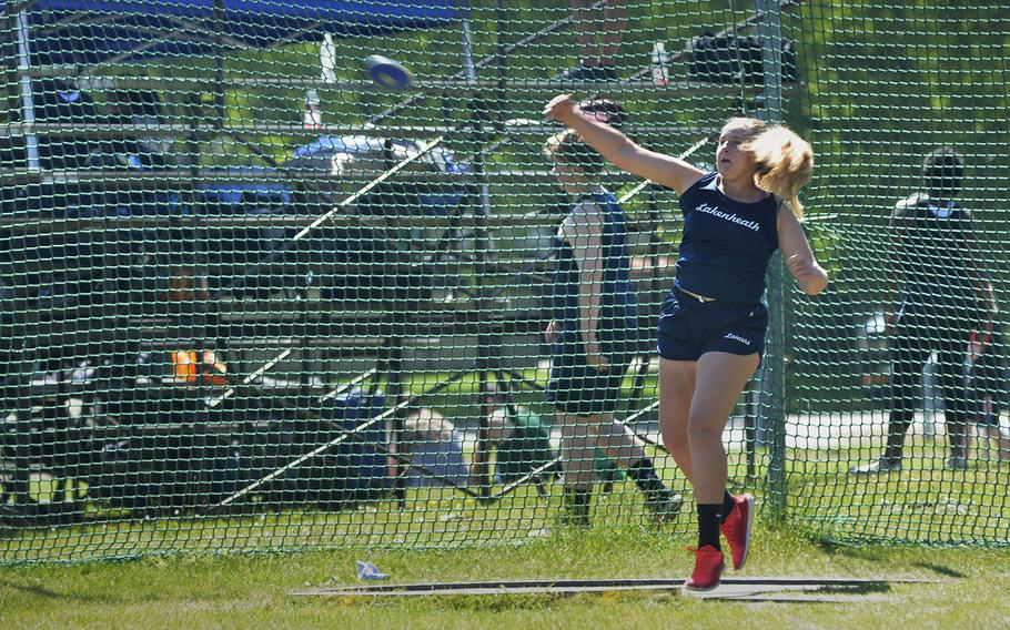 Lakenheath's Aubri Butler throws the discus 95 feet, 5.5 inches for first place during a high school track meet at RAF Lakenheath, England, Saturday, May 19, 2018.