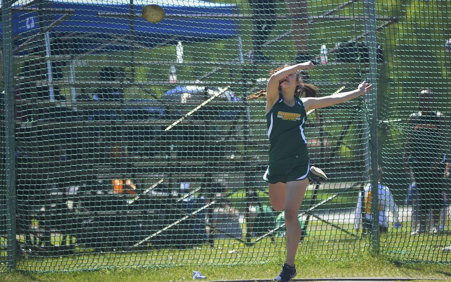Alconbury's Anna Downing throws a discus during a high school track meet at RAF Lakenheath, England, Saturday, May 19, 2018. Downing finished third after throwing 82 feet, 2.5 inches.