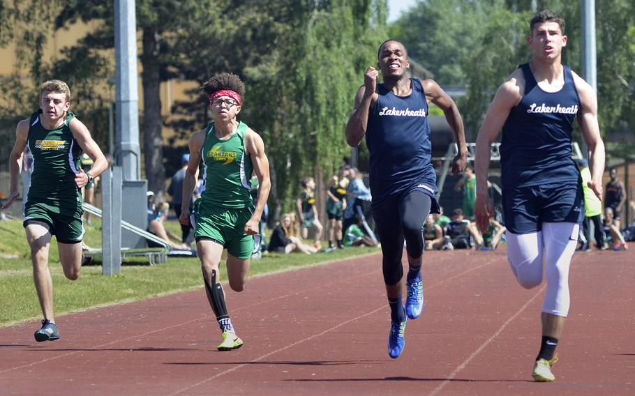 Lakenheath's Kobe Cox breaks away from teammate Deshawn Wilkerson in the 100-meter dash during a high school track meet at RAF Lakenheath, England, Saturday, May 19, 2018. Cox clocked in at 11.18 seconds for first place.