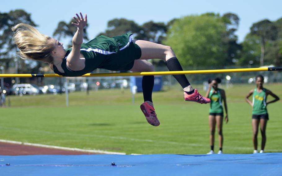 Alconbury's Marrisa Kastler floats over a high jump bar set to 4 feet, 7 inches during a high school track meet at RAF Lakenheath, England, Saturday, May 19, 2018. Kastler finished the day with second in high jump and first place in long jump and 200-meter dash.