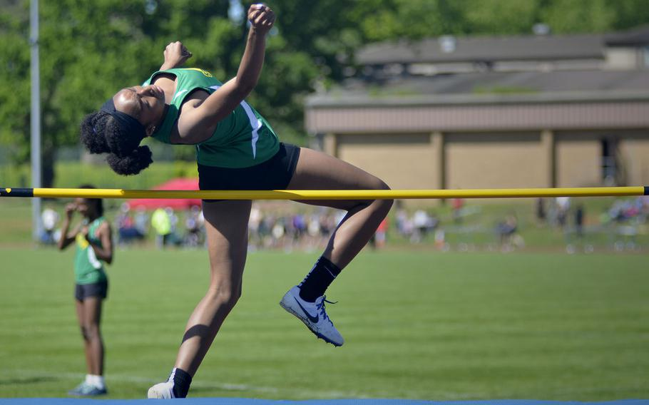 SHAPE athlete Mya Neals easily clears the bar for a 4-foot-7-inch high jump during a high school track meet at RAF Lakenheath, England, Saturday, May 19, 2018. Neal finished first with a high jump of 4 feet, 9 inches.