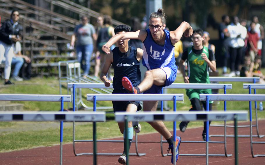 Brussels athlete Alparslan Sundseth pulls ahead in the 110-meter high hurdles during a high school track meet at RAF Lakenheath, England, Saturday, May 19, 2018. Sundseth clocked in at 16.44 seconds for first place.
