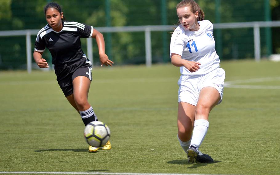 Wiesbaden's Audrey Merhar takes a shot as Vicenza's Angelina Yepez hurries back to help defend. Wiesbaden won the Division I game at the the DODEA-Europe soccer finals in Reichenbach, Germany, 3-1.