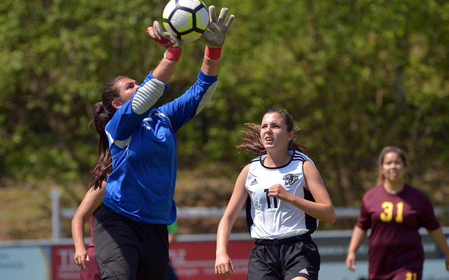 Vilseck's Mia Chon makes a save as Stuttgart's Natalie Eddy watches in Division I action at the the DODEA-Europe soccer finals in Reichenbach, Germany, Monday, May 21, 2018. Stuttgart won 4-0.
