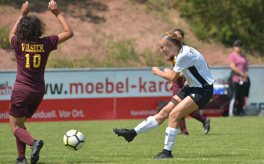 Stuttgart's Reagan Treichel shoots on goal in Division I action at the the DODEA-Europe soccer finals in Reichenbach, Germany, Monday, May 21, 2018. At left is Vilseck's Adely Huezo. The Panthers beat Vilseck 4-0.
