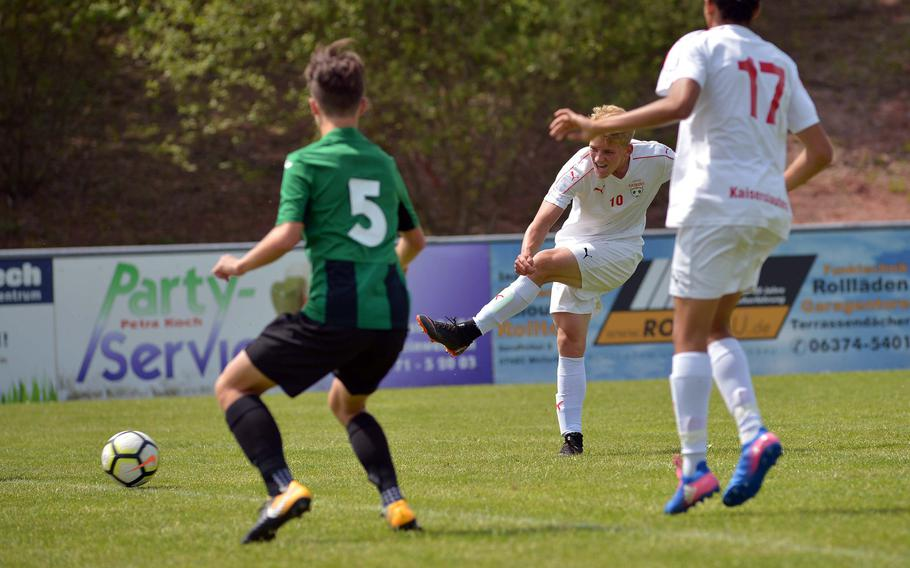 Kaiserslautern's Tyler Jankowski shoots and scores in a Division I game against Naples at the DODEA-Europe soccer finals in Reichenbach, Germany, Monday, May 21, 2018. Kaiserslautern won the game 6-1.