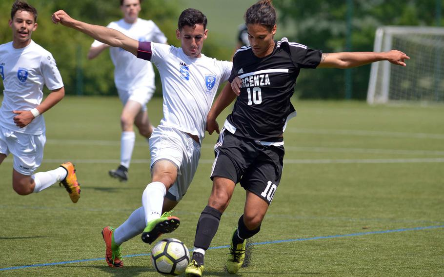 Wiesbaden's Andrew Scahill stops Vicenza's Richard Poropat in a Division I game at the DODEA-Europe soccer finals in Reichenbach, Germany, Monday, May 21, 2018. Wiesbaden won the game 6-0.