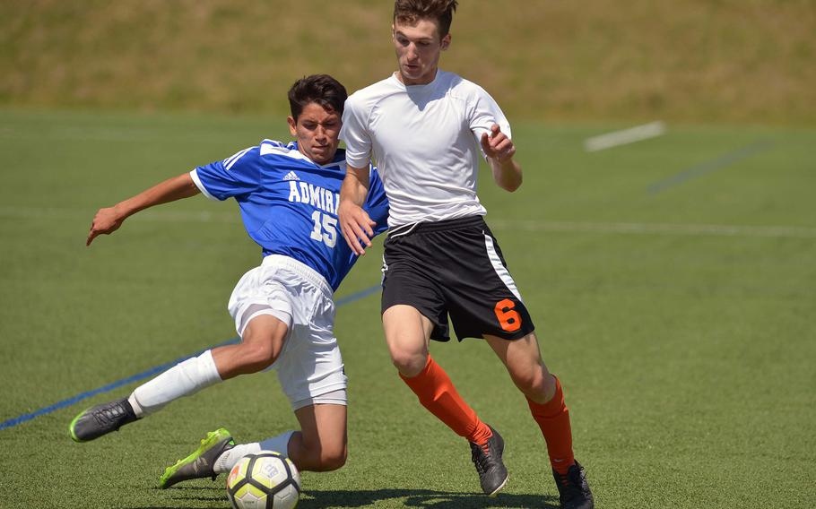 Rota's Kaden Rodriguez, left, comes in to clear in front of AFNORTH's Guillermo Rodriquez in Division II action at the DODEA-Europe soccer finals in Landstuhl, Germany, Monday, May 21, 2018. AFNORTH won 6-0.