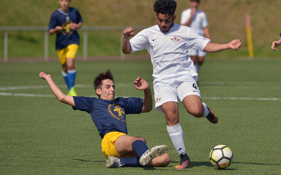 Florence's Mario Bacci, left, tackles Bahrain's Carlos Barrero in Division II action at the DODEA-Europe soccer finals in Landstuhl, Germany, Monday, May 21, 2018. Florence won 1-0.